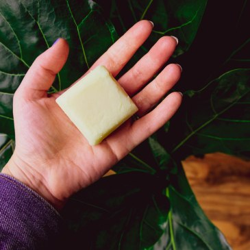 Hand holding lotion bar